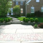 paver walkway leading down to sidewalk