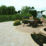 Paver patio with lawn chairs in corner