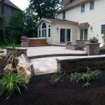Backyard paver patio with stone sitting walls