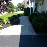 stone walkway leading to front porch of house