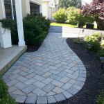 stone walkway leading to driveway