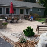 Paver patio with outdoor furniture, fire pit and custom firewood holder