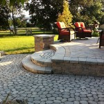 Backyard patio with rounded steps