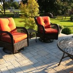 Wicker furniture with red cushions and metal outdoor table