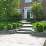 stone steps leading up to front door with stone garden beds