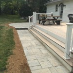 custom wood deck with stone walkway