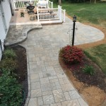 patio with large pavers installed in backyard