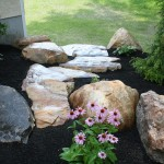 stone boulders placed on sides of stone steps