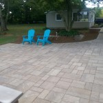 Sky blue adirondack chairs on backyard patio