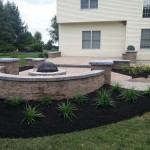 closeup of fire pit installed with sitting wall around it