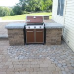 custom outdoor kitchen stone design with slot to fit grill