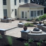 wraparound stone walkway connected to backyard patio with fire pit