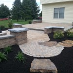 stone patio connected to walkway by stone steps
