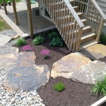 stone slabs leading to wooden porch steps