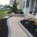 walkway with stone retaining wall and steps attached