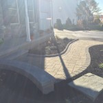 curvy paver walkway with retaining wall attached