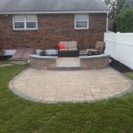 Rounded backyard patio with lounge furniture
