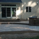 paver patio with upper level and circular retaining walls