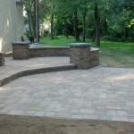 paver patio with stone steps leading up to sliding door