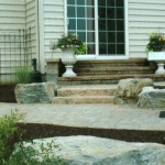 Bi-level patio with stone steps connecting the levels
