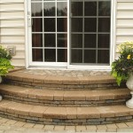 Rounded stone steps with flower pots on either end