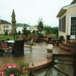 Large backyard patio with rounded edges