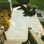 View of paver patio from top of deck