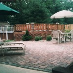 Backyard patio with lawn furniture, gazebo and above ground swimming pool
