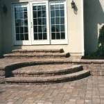 Rounded stone steps leading up to back door