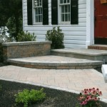 stone walkway with rounded steps and retaining wall