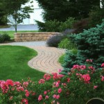 winding walkway going through front yard of house